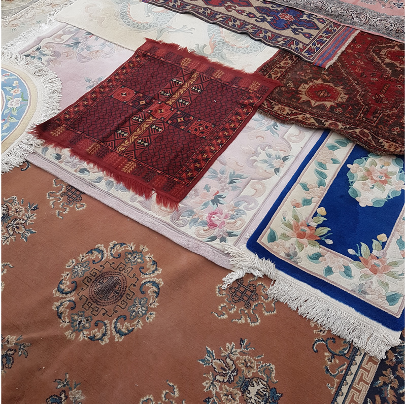 Rug Cleaning - image shows a selection of colourful overlapping rugs.