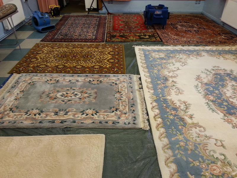 Rug Cleaning - image shows a selection of colourful rugs.