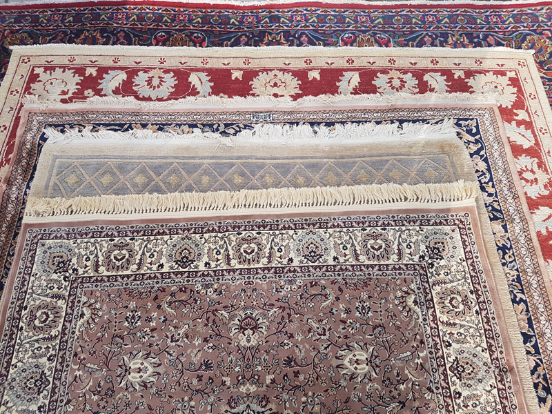 A selection of overlapping rugs.