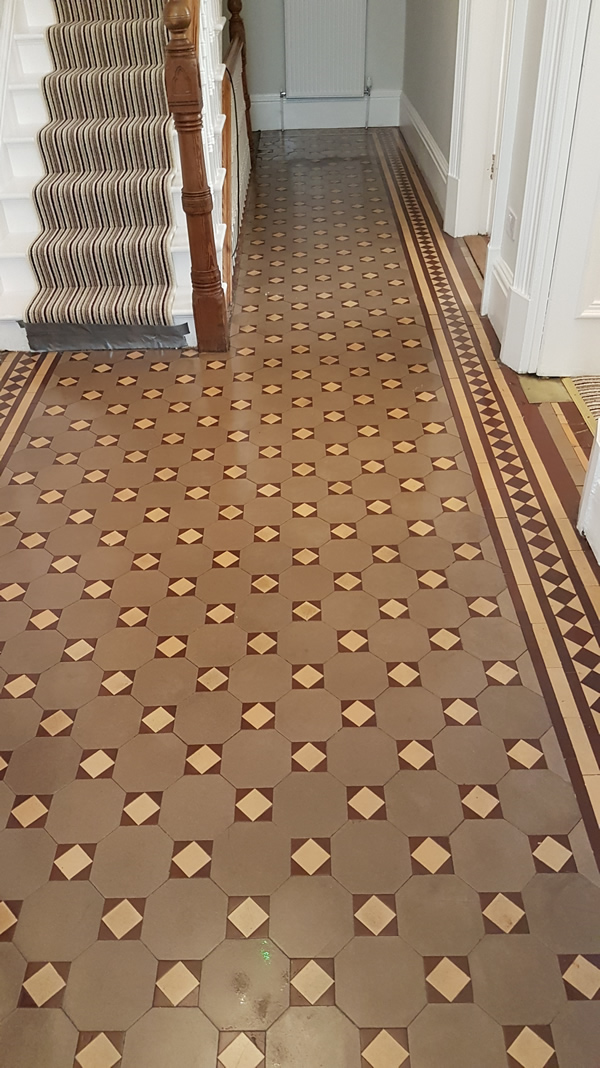 Image shows Victorian tiled floor after cleaning.